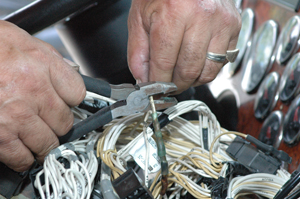 A cut here, a splice there: Today's complex electrical systems won't tolerate jury-rigged repair jobs. There are fewer and fewer user-serviceable systems on trucks. (Photo by Jim Park)