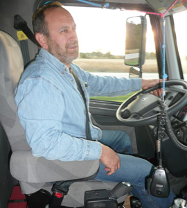Once they're used to work-saving AMTs, drivers usually like them. One happy cruiser is Perry Allen, who drives a Volvo VHD dump truck with an I-Shift for Klink Trucking out of Ashley, Ind. (Photo by Tom Berg)