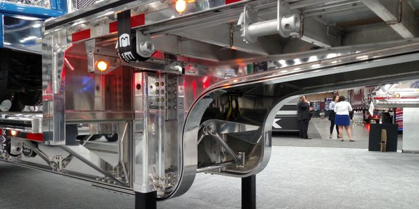 A Mac Trailer aluminum drop deck's transition area includes the 90-degree step (upper left) and...