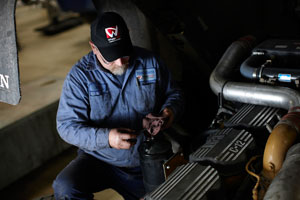 Extended drain intervals don't mean you can ignore the truck in between oil changes. Here, technician Bill Reeb of W.W. Williams in Birmingham, Ala., checks the oil level during a routine preventive maintenance check. (Photo courtesy of WheelTime Network)