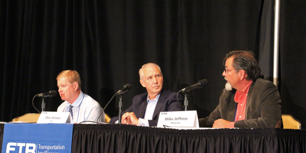 From left, Greg Eddy, president and CEO of Venture Logistics;Don Hinkle, vice president of...