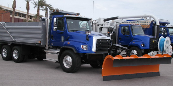 Latest severe duty models from Freightliner are (from left) 114SD with setback steer axle,...