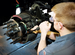 A technician repairs a Meritor air brake. With the new stopping rule, service providers can expect changes in 2011.