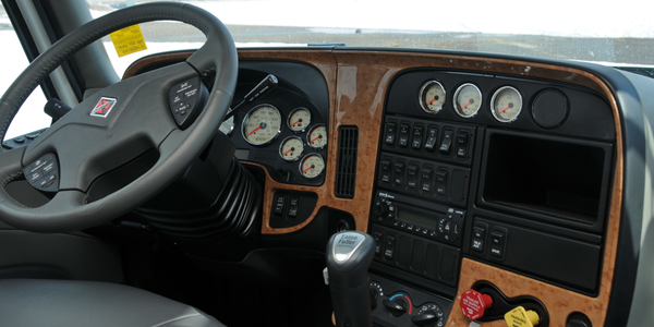 The cockpit is familiar territory, except for the DEF tank level gauge.