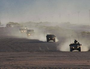 Military patrols and supply convoys face increased danger at night, and better headlamps have been helping soldiers in Iraq and Afghanistan. (Photo: convoy at Ft.Irwin; Credit: AM General Corp.)