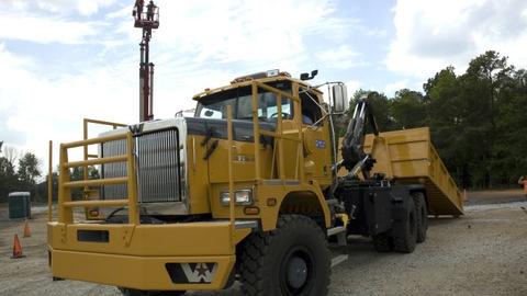 Western Star's new 6900XD, hooked to a SmithCo 70-ton side dump trailer. Photos: John G. Smith