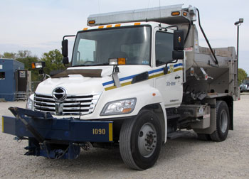 This compact but tough Hino 338 is one of 175 ordered by West Virginia's Highway Department. The 2010 model has old wing-like grille bars; new 2011s have blockier styling. (Photo by Tom Berg)