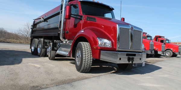 The T880's cab is 8 inches wider and the hood's sculpted lines are smoother than what have been...