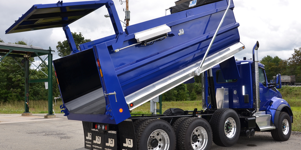This 18-foot steel dump body has a combination double-acting and high-lift tailgate that works...