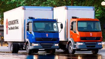 Kenworth introduces two medium duty cabovers. From left are the new Kenworth K270 Class 6 cabover and the Kenworth K370 Class 7 cabover.