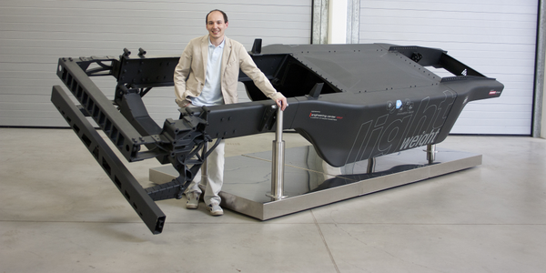 Gregor Schwarz of Austria's Engineering Center Steyr stands proudly with the lightweight...