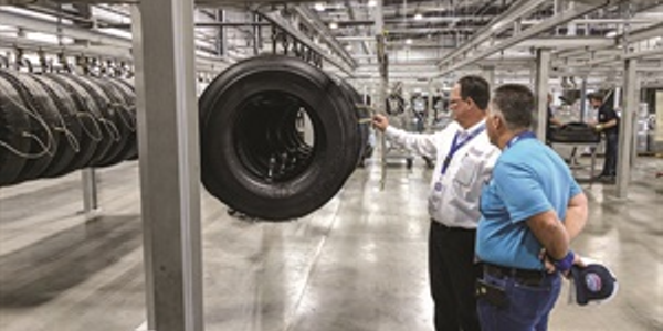 Larry Lafreniere, Houston sales manager for Beasley Tire Service, explains the retreading...