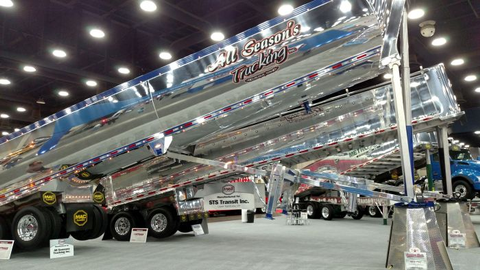 New Mac aluminum end-dumps gleam in the lights of the Mid-America Trucking Show earlier this...