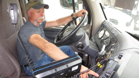 Meijer Logistics driver Ron Diamond points to the button that can save him considerable work and...