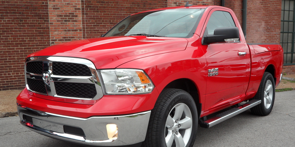 The Ram 1500 2-door Regular cab has SLT trim, standard with chrome grille and bumpers. This...