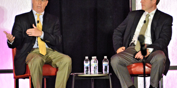 Transplace CEO Tom Sanderson, right, shares the stage with trucking analyst Thom Albrecht,...