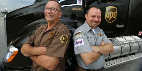 UPS driver Bill Lazarski of Chicago (left) and UPS Freight driver Paul Savill of Cincinnati...