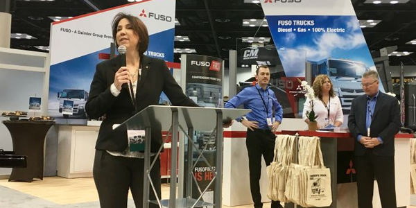 Jecka Glasman, president and CEO of Mitsubishi Fuso, announcing new products at the Work Truck...