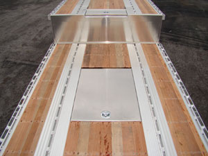 East has introduced new safety option to their drop deck trailers, an all-aluminum tarp storage box built into the floor of the upper or lower deck.