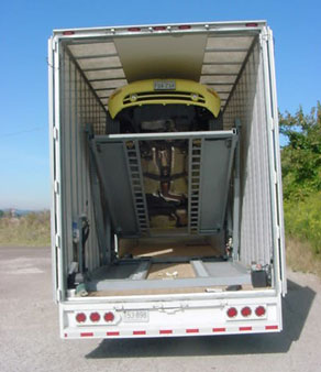 Above is a 53-foot-long, 102-inch wide trailer with Kentucky drop frame/electronics van trailer with car transport module equipment inside. The sharp angle of the upper rear yellow car demonstrates the pivot range of the hydraulic upper decks.