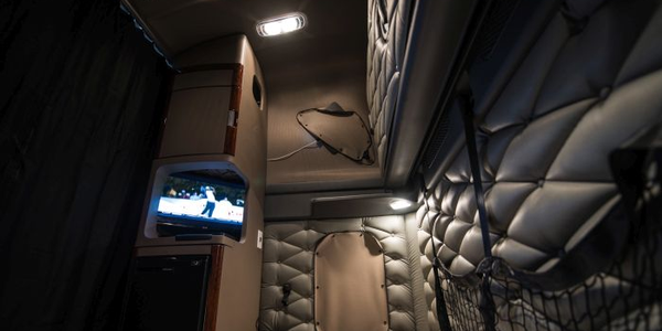 A golf tournament is displayed on the EpicVue flat-screen TV inside a truck's sleeper. The...