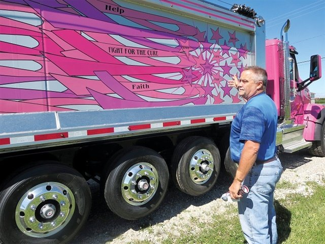 "Mike Culbertson collaborated on this ""Fight for the Cure"" design for a new Alfab aluminum dump body aboard a Peterbilt Model 567 chassis. Photo: Tom Berg"