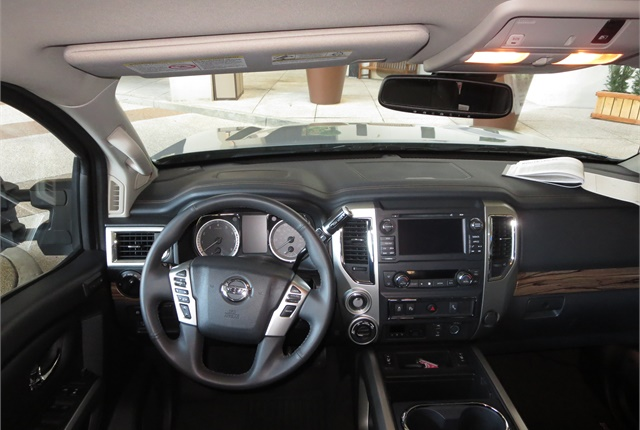 XD includes handsome but functional instruments and controls. Pro-4X interior is the middle one of five trim levels, yet includes leather-covered seats.
