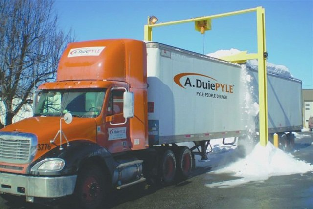 The plow-like scraper removes snow as the trailer moves under the device. A rubber tip on the steel blade protects the roof. Pyle has 15 installed at its terminals in the Northeast, with two more scheduled.
