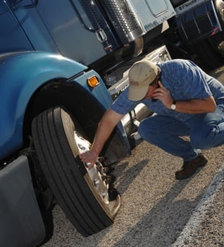 Flat tires never seem to occur in convenient locations. Luckily, many tire manufacturers today have quick-response, roadside assistance programs to help your truck get moving again. Photo: Goodyear