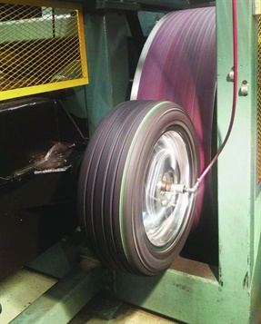 Machines such as this one used by Smithers Rapra, a third-party tire testing company, test rolling resistance under tightly controlled conditions. Photo: Smithers Rapra