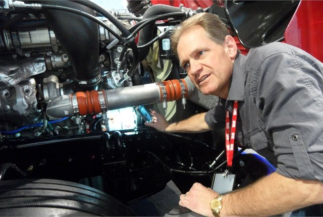 Key to Bruce Hudson's change to Heartland Express's tractors is a larger alternator and mounting batteries on frame rails so they'll stay cool.