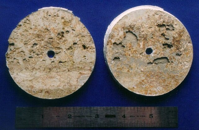 Samples cut from a tank truck wall showing severe pitting attack of aluminum after it was exposed to a corrosive solution for a couple of days.