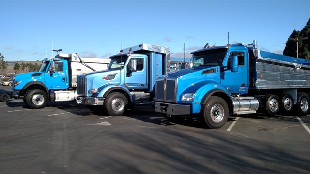 "One thing for sure in the competition: A blue truck would win. Kenworth's T880 (at far right) scored the highest vs. (from left) the International WorkStar 7600 and Peterbilt 567. Bottom line: The KW ""was a nicer truck to drive."" Photo: Tom Berg"