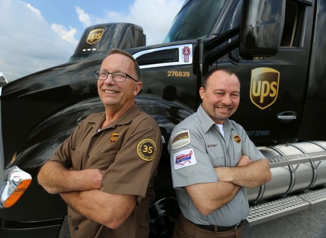 UPS driver Bill Lazarski of Chicago (left) and UPS Freight driver Paul Savill of Cincinnati (right) are fans of the collision mitigation technology that's now standard equipment on every new UPS Class 8 tractor the company orders.