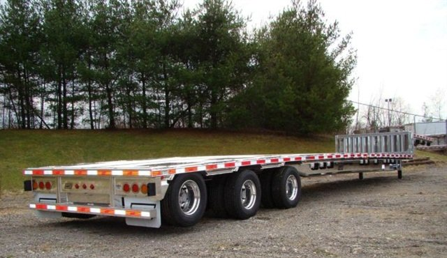 Tridem-equipped dropdeck, flatbed and dump trailers are commonly produced by East and other manufacturers. A proposal in Congress would allow one of these to carry 11,000 pounds more gross weight, or 91,000 pounds total.