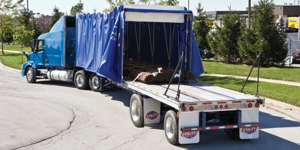 Rolling tarp systems, like TarpStop's FasTrack, protect loads but can be opened or closed in a...