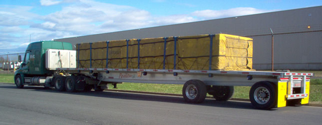 An HWC rig can carry up to 54,000 pounds of building supplies, thanks to the 8,000-pound tare weight of Fontaine Revolution flatbeds.  The company began as a private carrier, and is now a for-hire fleet of 130 trailers and 100 tractors.