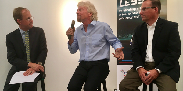 "Richard Branson (center) expounds on how trucking's mpg efforts are a ""ray of hope"" in the..."