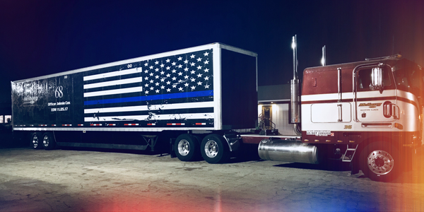 Blue stripe across a mourning version of the American flag honors fallen police officers. This...
