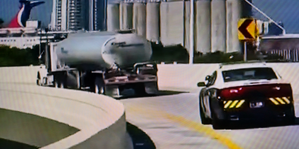 Gasoline tankers are getting police escorts, like this one in Miami. Florida's governor has...