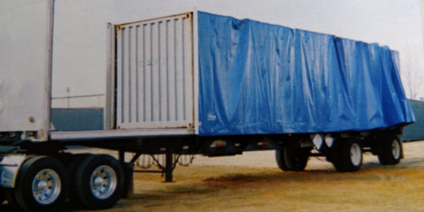 Rolling tarps retract either forward or aft to allow a flatbed to be loaded normally. Then, when...