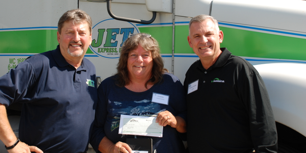 Tammy Newcomer, center, with Jet Express President Kevin Burch, left, and Vnomics' Ed McCarthy....