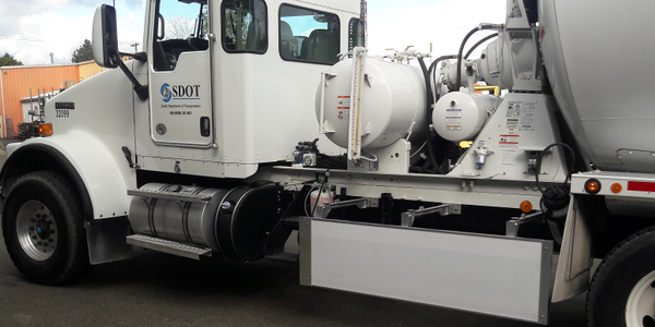 Seattle DOT's concrete mixer truck has a Walker Blocker side guard to close the gap ahead of the...