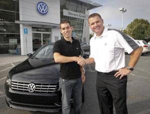 The first 2012 Passat owner, Matt Duchesne, receives his all-new clean-diesel-powered Volkswagen from Mike Gabbani, general sales manager at Stevens Creek Volkswagen, in San Jose, Calif.