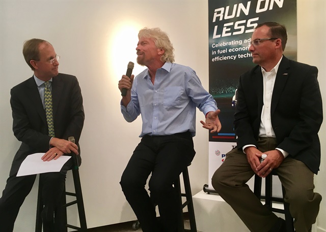 """Richard Branson (center) expoundson how trucking's mpg efforts are a """"ray of hope"""" in the global campaign to save fuel and protect the planet from climate change. Looking on (right) is NACFE's Mike Roeth. Photo: David Cullen"""