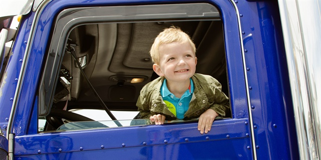 Braydon Martin is all smiles in a Make-A-Wish Convoy truck. (Photo courtesy RoadPro Family of Brands)