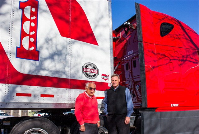 Duane Acklie, chairman of Crete Carrier Corp. (left), and Tonn Ostergard, president and CEO, receive Wabash National's 500,000th DuraPlate van trailer.
