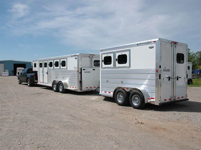 Pairs of light- and medium-duty trailers, like these horse transporters, will be seen more often on interstate highways, thanks to the federal FAST Act. Photo: NATM