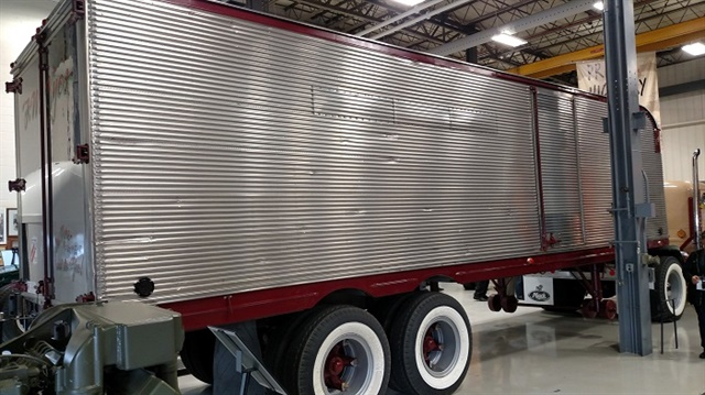 Fluted stainless steel sides are highly polished, with only some minor dents marring the mirror finish. The trailer, too, has whitewall tires. Museum's tight confines made for sharply cropped views.