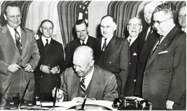 President Eisenhower signs the Federal Aid Highway Act into law on June 29, 1956. Photo: Federal Highway Adminstration